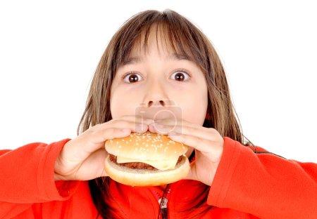 Little girl eating hamburguer