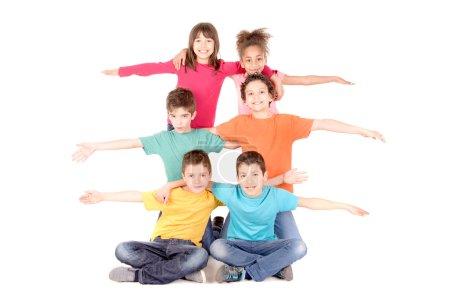 Foto de Grupo de niños aislados en blanco - Imagen libre de derechos