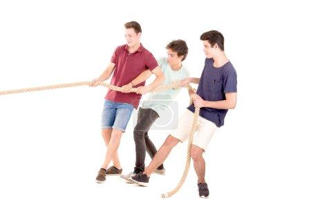 Teens playing rope game