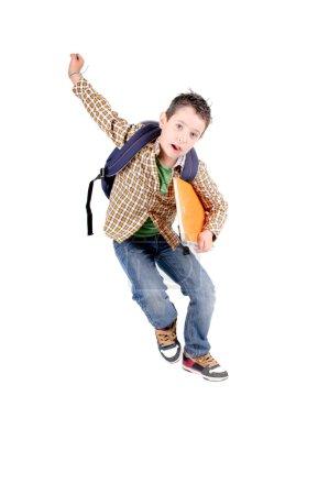 Foto de Niño saltando aisladas en blanco - Imagen libre de derechos