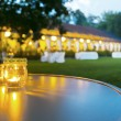 Outdoor table setting at wedding reception...