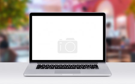 Photo pour Front view of modern laptop mockup with white blank screen on the office desk. Coffee shop on the background. - image libre de droit