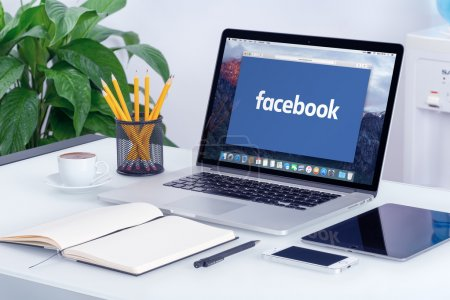 Facebook new logo on the Apple MacBook Pro screen