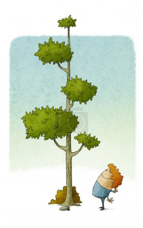 Photo for Child looks at how a tree grows - Royalty Free Image