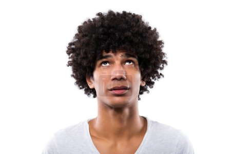 Photo for Man with afro hair looking up, studio shot - Royalty Free Image