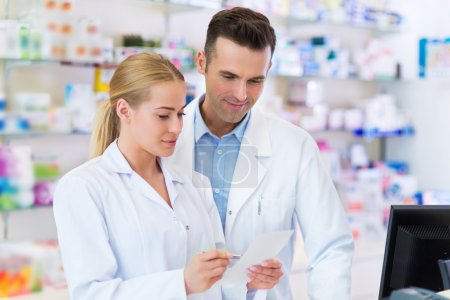 Female and male pharmacists