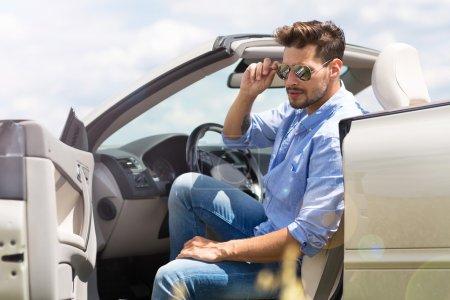 Man in convertible