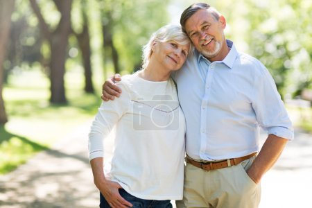 Photo for Senior couple embracing outdoors - Royalty Free Image