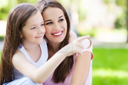Photo for Mother and daughter pointing at something outdoors - Royalty Free Image