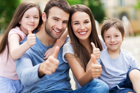 Photo for Happy family portrait with thumbs up gesture - Royalty Free Image