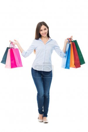 Photo for Young Woman holding shopping bags isolated on white background - Royalty Free Image
