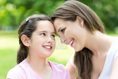 Photo for Happy mother and little daughter outdoor in park - Royalty Free Image