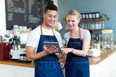 Small business owners in coffee shop