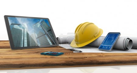 Tablet, smartphone, safety helmet and blueprints on wooden table