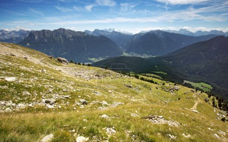 alpine meadow with panoramic view of the Dolomites