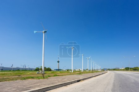 wild turbines along the road in industrial zone