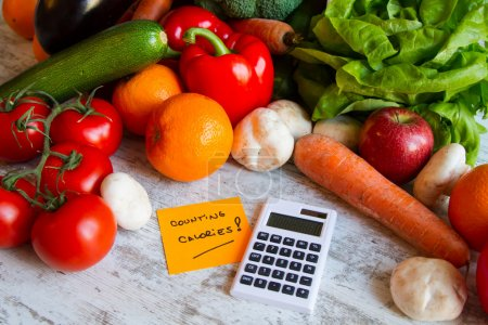 Photo for Counting calories, diet of  vegetables and fruit - Royalty Free Image