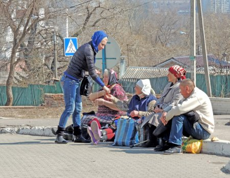 Woman gives charity at Orthodox Easter