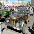Постер, плакат: Retro car soviet military jeep UAZ 69 and army food truck