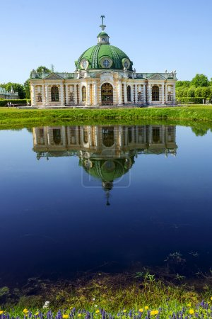 Grotto pavilion with reflection in the water park Kuskovo, Mosco