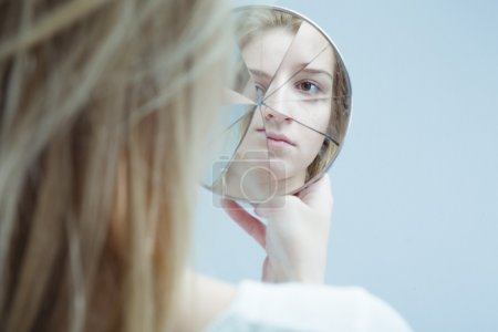 Photo for Image of woman with mental disorder holding broken mirror - Royalty Free Image