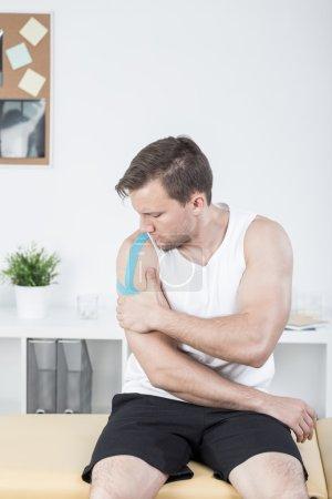 Sporty man with arm injury