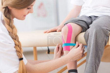 Kinesio taping therapy after knee injury