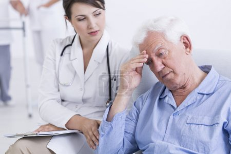 Photo for Shot of a young doctor comforting a sad senior man in a nursing house - Royalty Free Image