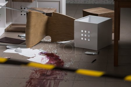 Photo for Overturned office furniture and a huge mess at the crime scene - Royalty Free Image