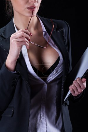 Photo for Sexy attractive businesswoman tempting her body at work - Royalty Free Image