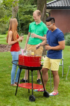 Photo for View of diverse friends on a barbecue - Royalty Free Image
