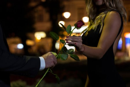 Photo for Woman getting rose on the first date - Royalty Free Image