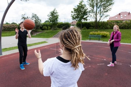Photo for Group of friends playing basketball in a park - Royalty Free Image