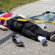 Caution tape and dead man lying on the street, hor...
