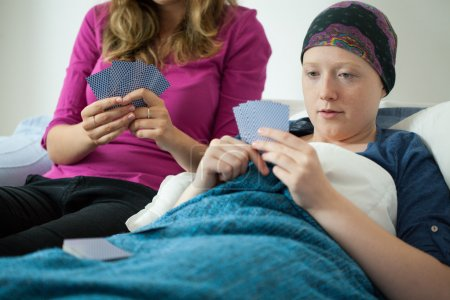 Playing cards with friend with cancer