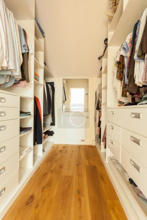 Photo for View of bright spacious closet in modern house - Royalty Free Image