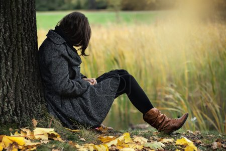 Photo for Woman contemplating alone in the autumn park - Royalty Free Image
