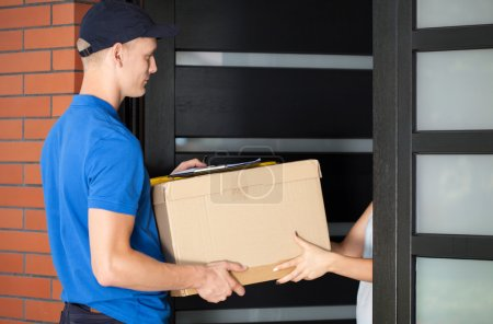 Delivery man handing in parcel