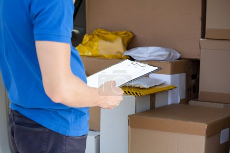 Checking van full of parcels