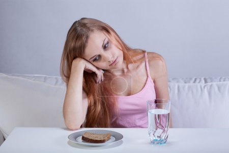 Photo for Portrait of young depressed girl with eating disorder - Royalty Free Image