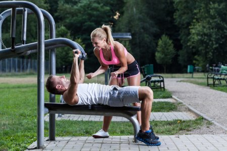 Photo for Young woman keeping her fingers crossed for her training boyfriend - Royalty Free Image