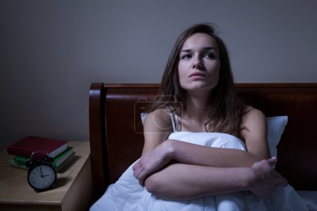 Photo for Pensive woman stying sleepless in bed at night - Royalty Free Image