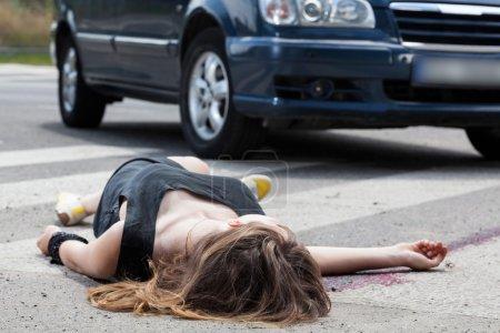Dead woman on the street