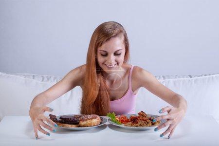 Girl binging on lots of food