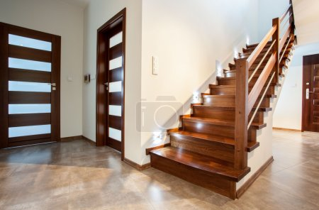 Photo for Luxury hallway with woden stairs to bedroom on teh floor - Royalty Free Image