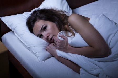Photo for Image of scared woman trying to sleep - Royalty Free Image