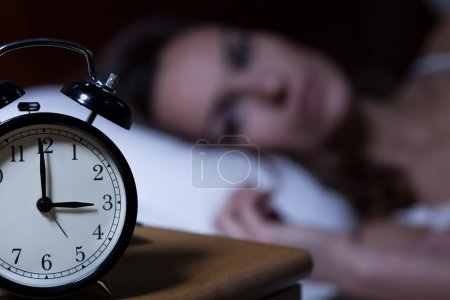 Photo for Close-up of alarm clock on night table - Royalty Free Image