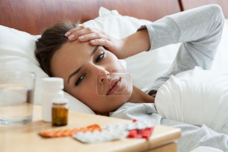 Ill woman feeling headache