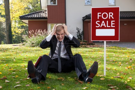 Photo for Young irate man trying to sell the house - Royalty Free Image