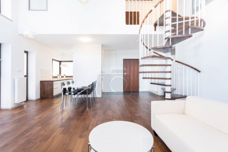 Photo for Big modern lounge with wooden spiral stairs - Royalty Free Image